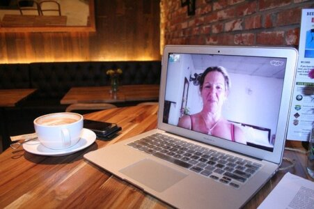 photograph of a workplace in 2020 - home office with computer video conferencing