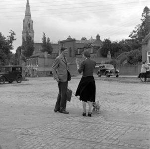 Photograph of Photographer Elinor Wiltshire  in cattle market Dublin, 16 June 1954.