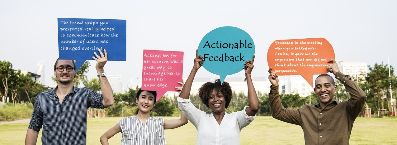 Photo of 4 people holding up speech bubbles with actionable feedback in each one
